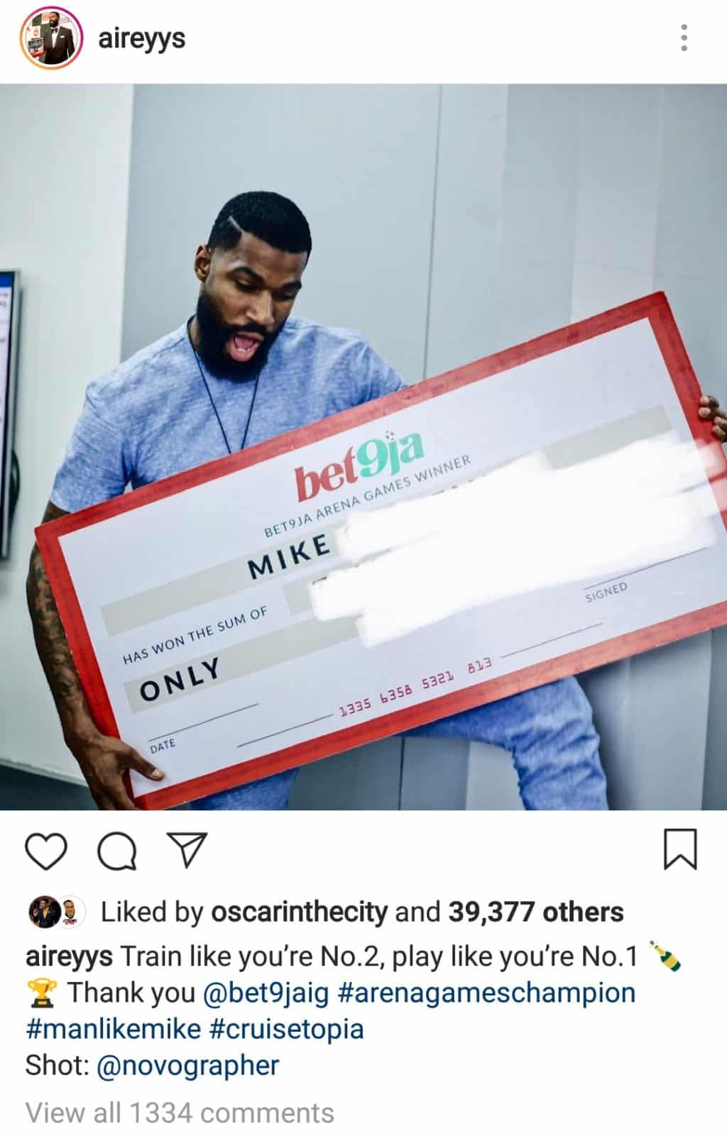 Mike receives his N2million cash prize for winning the BET9ja Arena Games
