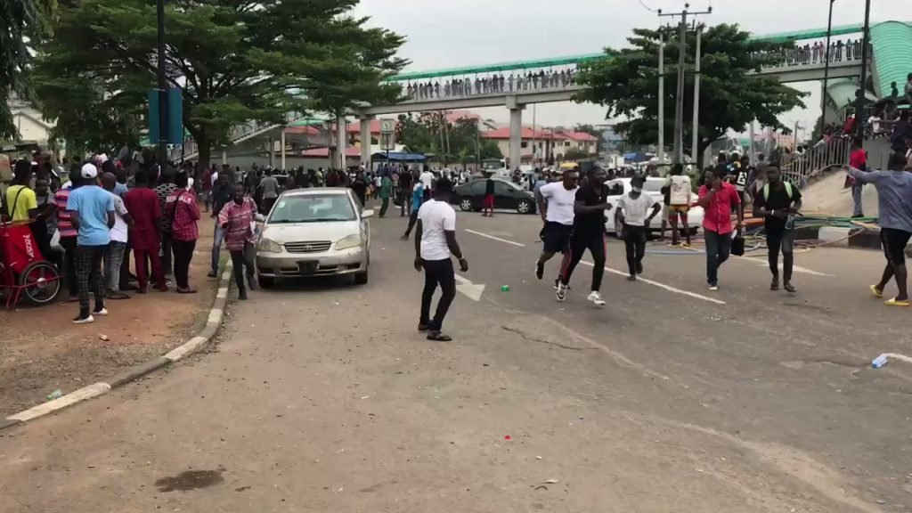 #EndSARS: Hoodlums Attack Protesters With Knives, Machetes In Lagos (Watch Video)