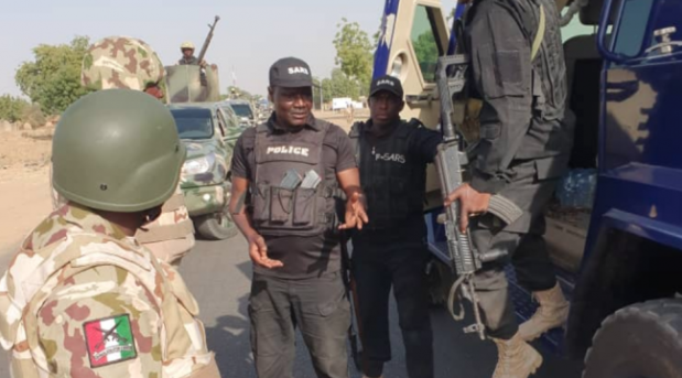 #EndSARS: Soldiers Beat Police Officer For 'Extorting' Motorists In Aba (Watch Video)